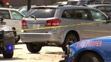 Investigators appeared to be concentrating on an SUV that a witness said belonged to the suspects.