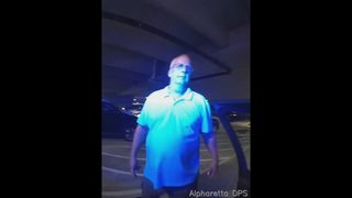 Police say dispute over parking spot led man to hit another with his car -- twice