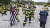 Firefighters begin their climb up Stone Mountain in observance of September 11