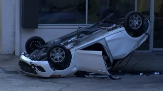 Car falls from 2nd story parking lot, nearly crushing worker below