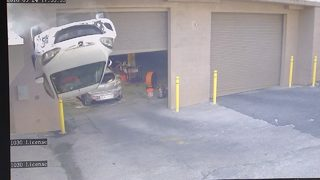 Dramatic video shows car flip off parking garage in NW Atlanta