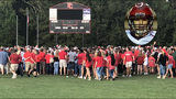 Community comes together to pray for football player seriously injured in game