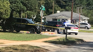 Officers shoot, kill man holding replica machine gun, GBI says