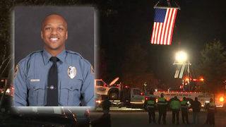 Hundreds pack vigil to honor fallen officer
