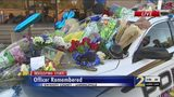 Tribute for fallen officer set up outside police headquarters