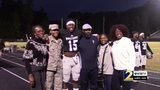 High school football player surprised by Air Force sister during big game