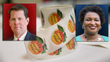 Brian Kemp and Stacey Abrams and voting stickers