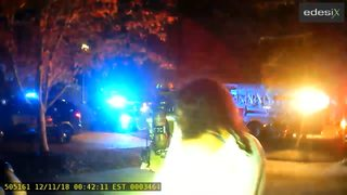 Body cam video shows two officers rush into burning home, save woman