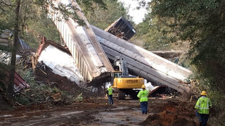 Train derailment forces town to evacuate, damages state highway