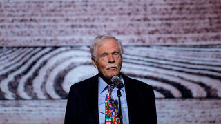 Ted Turner sings at his 80th birthday party, says 'still working