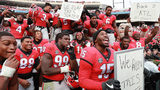 "Georgia players celebrate with ""We Run This State"" signs after beating Georgia Tech 45-21 in their NCAA college football rivalry game on Saturday, Nov. 24, 2018, in Athens. Curtis Compton/ccompton@ajc.com"