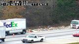 FedEx trucks spill packages on I-75