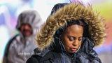 Eva Harden braving the cold at the Northside MARTA transit station on Tuesday, Jan. 16 2018. (JOHN SPINK / JSPINK@AJC.COM)
