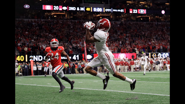 5c8b5db29bd DeVonta Smith catches a 41 yard touchdown pass to beat the Georgia Bulldogs  in the CFP National Championship presented by AT T in overtime at  Mercedes-Benz ...