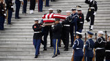 WASHINGTON, DC - DECEMBER 05:  A joint services military honor guard carries the casket of former U.S. President George H. W. Bush from the U.S. Capitol to transport it to Washington National Cathedral December 5, 2018 in Washington, DC.