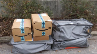 Nearly 100 Amazon packages dumped on the side of the road