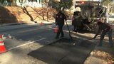 Crews work on repairing a pothole in Atlanta.
