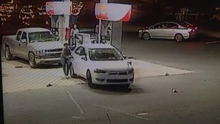 Video shows carjacker targeting woman at busy gas station