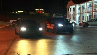 Motel SWAT standoff ends after gunshots; 2 arrested