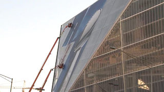 Massive tents, cellphone towers and banners going up ahead of Super Bowl