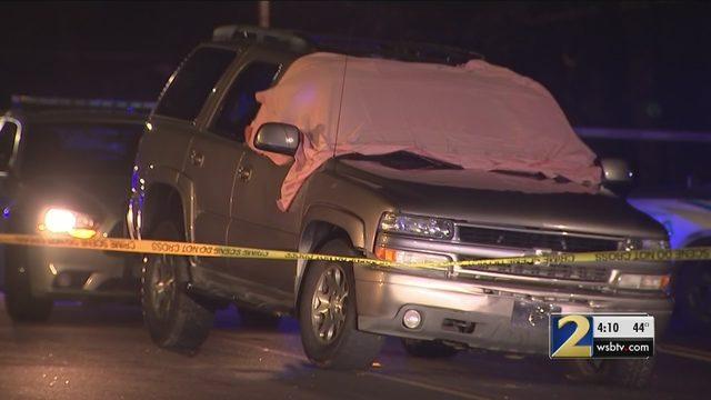 Man shot in SUV drives away, dies on busy road in DeKalb