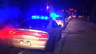 Two women killed in triple shooting in Covington; suspect in custody