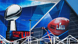 Jan. 17, 2019 Atlanta: Workers use a lift to install a Super Bowl LIII wrap on the outside of Mercedes-Benz Stadium as it is transformed for the big game on Thursday, Jan. 17, 2019, in Atlanta. Curtis Compton/ccompton@ajc.com