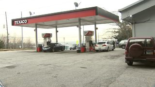 Family hides from gunman at gas station; only separated by office, glass window