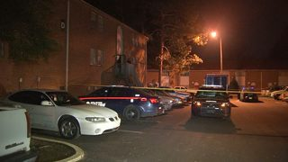 Woman shoots, kills intruder trying to break into apartment, police say