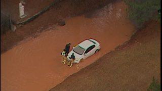 Car stuck in standing water in DeKalb County