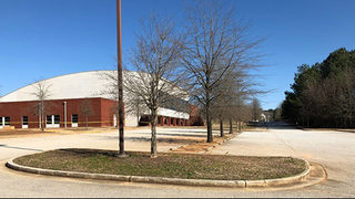 Police searching for gunman who opened fire in high school parking lot