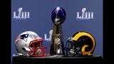Detail of the Lombardi Trophy and the helmets of the New England Patriots (left) and the Los Angeles Rams prior to NFL Commissioner Roger Goodell speaking during a press conference on January 30, 2019 in Atlanta. (Photo by Mike Zarrilli/Getty Images)