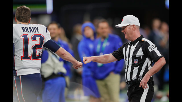 Tom Brady  12 of the New England Patriots fist-bumps a referee prior to  kickoff during Super Bowl LIII against the Los Angeles Rams at  Mercedes-Benz Stadium ... f101a4a34