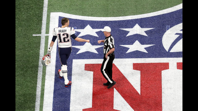 295d696574c Tom Brady #12 of the New England Patriots greets referee John Parry #132  prior to Super Bowl LIII against Los Angeles Rams at Mercedes-Benz Stadium  on ...