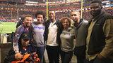 Steven Skinner and his family eith actor Chris Tucker at Super Bowl LIII in Atlanta