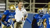 McEachern head coach Kyle Hockman (center) takes the field along with the Indians prior to the start of their game against Cedar Grove Friday, Sept. 7, 2018, at McEachern High School in Powder Springs. Photo: Daniel Varnado/For the AJC