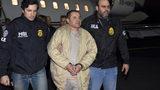 """FILE: Authorities escort Joaquin """"El Chapo"""" Guzman, center, from a plane. (U.S. law enforcement via AP, File)"""