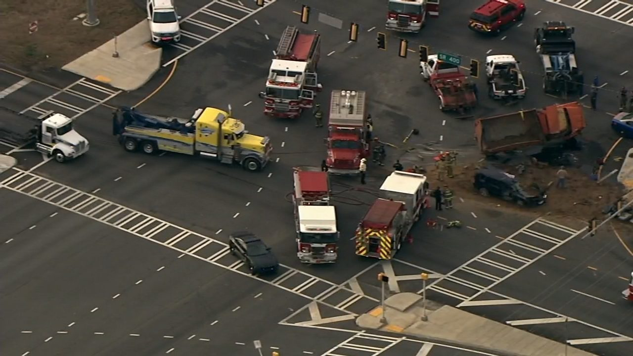 Serious crash involving car, dump truck shuts down major road in