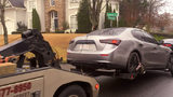 Maserati being towed from scene of a raid in Sandy Springs