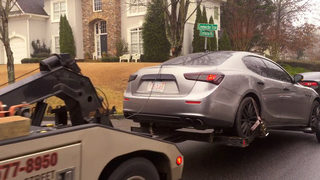 Maserati towed from scene of FBI raid in upscale neighborhood