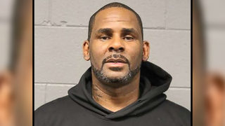 R. Kelly turns himself in to police on sexual abuse charges involving minors