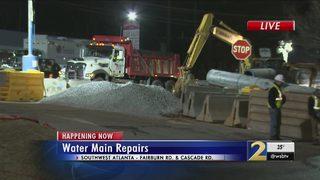 Massive water main break floods businesses, parking lot in southwest Atlanta