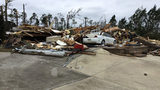 The National Weather Service in Birmingham says an EF-4 tornado with winds of 170 mph caused catastrophic damage in Lee County, Alabama.