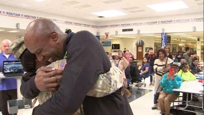 SOLDIER SURPRISE: Army specialist surprises dad, brothers at metro Atlanta high school