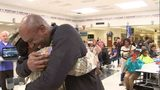 SPC Ameniah Hodge, who has been deployed overseas for months, hugs her father as she surprises him at Heritage High School in Conyers.