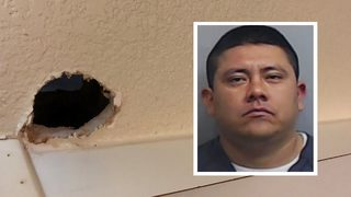 Man accused of watching woman in hotel room through hole in wall