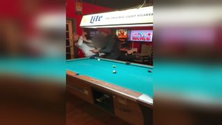 Video shows 2 men in bar fight after argument over pool table escalates