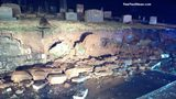 Two vaults containing caskets became uncovered from the wall collapse. (Photo: Courtesy of RealFastNews.com)