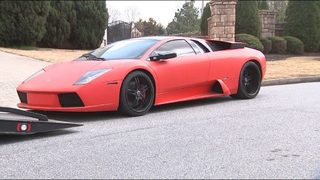 Lamborghini, luxury cars seized in raids at several metro Atlanta homes