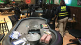 The Georgia Bureau of Investigation's gambling unit -- along with the McDonough Police Department -- executed a search warrant at Motorheads Bar Wednesday night. (Photo: WSB-TV)